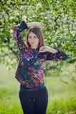 Girl posing under apple-tree Royalty Free Stock Image
