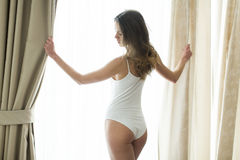 Girl posing in underwear by window Stock Image