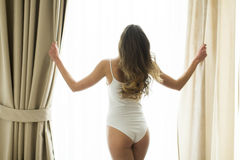 Girl posing in underwear by window Royalty Free Stock Photography