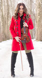 Girl posing with violine. Beautiful young girl play with snow stock photos