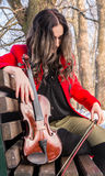 Girl posing with violine. Beautiful young girl playing violin royalty free stock photos