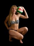 Girl posing with volleyball Stock Photos