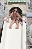 Girl posing on waterslide Royalty Free Stock Photography