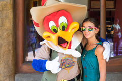 Girl posing with Woody Woodpecker Stock Images