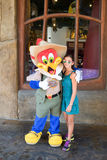 Girl posing with Woody Woodpecker Royalty Free Stock Photography