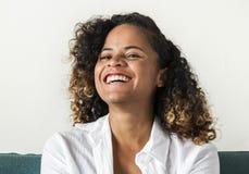 A girl with a positive smile relaxing concept Stock Photos
