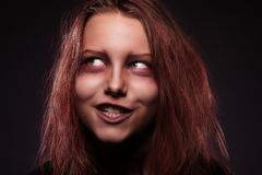 Girl possessed by a demon Stock Photography
