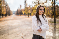Girl possing in autumn park Royalty Free Stock Images