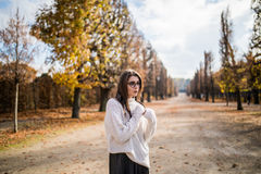 Girl possing in autumn park Royalty Free Stock Photos