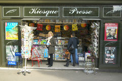 Girl at postcard stand, Paris, France, model release Stock Images