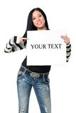 Girl with the poster. The smiling girl specifies in a poster having control over on a white background Stock Image