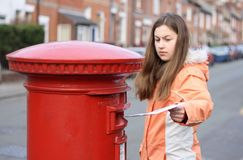 Girl posting letter Stock Photography