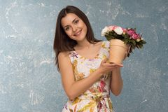 Girl with pot of flowers Royalty Free Stock Images