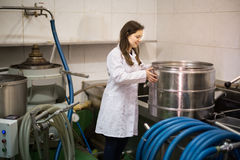 Girl with pot at olive oil industry Royalty Free Stock Photography