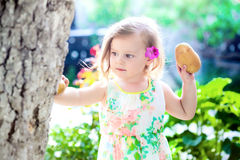 Girl with a potato Royalty Free Stock Photo