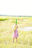 Girl poured from a water pistol. Royalty Free Stock Photos