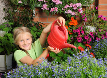 Girl pouring flowers Royalty Free Stock Photos