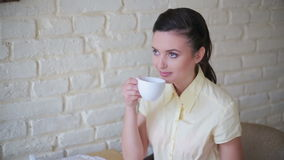 Girl is pouring green tea in the restaurant stock video