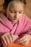 Girl pouring medicine Royalty Free Stock Photos
