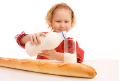 Girl pouring milk Royalty Free Stock Photography
