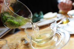 Girl pouring mint tea Royalty Free Stock Images