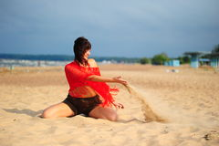 The girl pouring out sand Royalty Free Stock Image