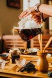 Girl pours fresh green tea in coffee stock photos