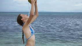 Girl pours on herself coconut juice stock footage