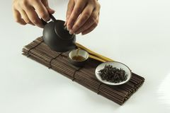Girl pours tea during chinese tea ceremony royalty free stock photos