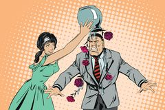 Girl pours vase of flowers on man`s head. Male is in shock.  Stock Image