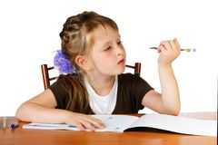 Girl with pout looks at the pen Stock Images