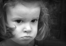 Girl pouting. Baby girl with a frown royalty free stock images