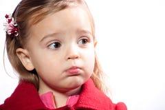 Girl pouting. Girl wearing red coat pouting Royalty Free Stock Image