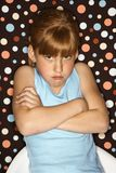 Girl pouting with arms crossed. Royalty Free Stock Image