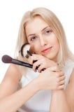 Girl with powder brush Stock Photos