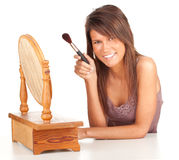 Girl with powder brush and mirror Royalty Free Stock Photo
