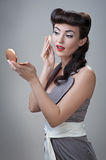 Girl powders her face Stock Photography