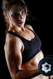 Girl power. Young woman shows off her muscles Royalty Free Stock Images