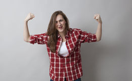 Girl power concept for laughing muscle young brunette Stock Photo