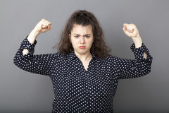 Girl power concept for unhappy overweight young brunette Stock Photo