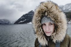 Girl power. Female adventurer portrait. Woman outdoors. Lifestyle image of young woman at winter wonderland. Grundlsee, Austria royalty free stock photography