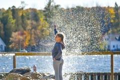 Girl Power, Girl Standing in front of Splashing Wave