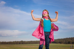 Girl power super hero. Confidence in kids or children royalty free stock photography