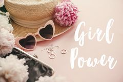 Girl Power text sign at stylish girly pink retro sunglasses, peonies, jewelry, hat, purse on pastel pink paper. Happy Women`s Day. International womens day, 8 royalty free stock photo