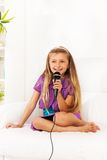 Girl practice singing Royalty Free Stock Photos