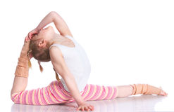 Girl practice yoga. Cute little girl practice yoga. Isolated on the white background Royalty Free Stock Image