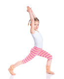 Girl practice yoga. Cute little girl practice yoga. Isolated on the white background Stock Images