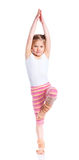 Girl practice yoga. Cute little girl practice yoga. Isolated on the white background Stock Photography