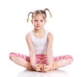Girl practice yoga. Cute little girl practice yoga. Isolated on the white background Stock Photos