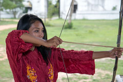 Girl practicing archery Royalty Free Stock Images